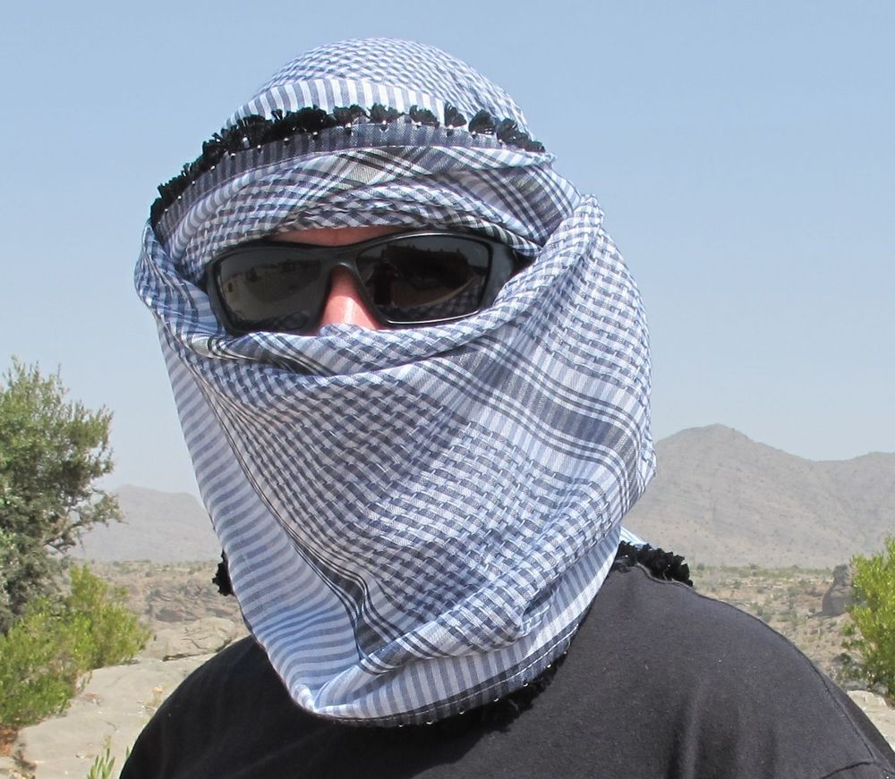 The Omani head scarf, extreme style! You'd only wear it across your face like this to protect against wind and sand. Or if you're an international man of mystery....