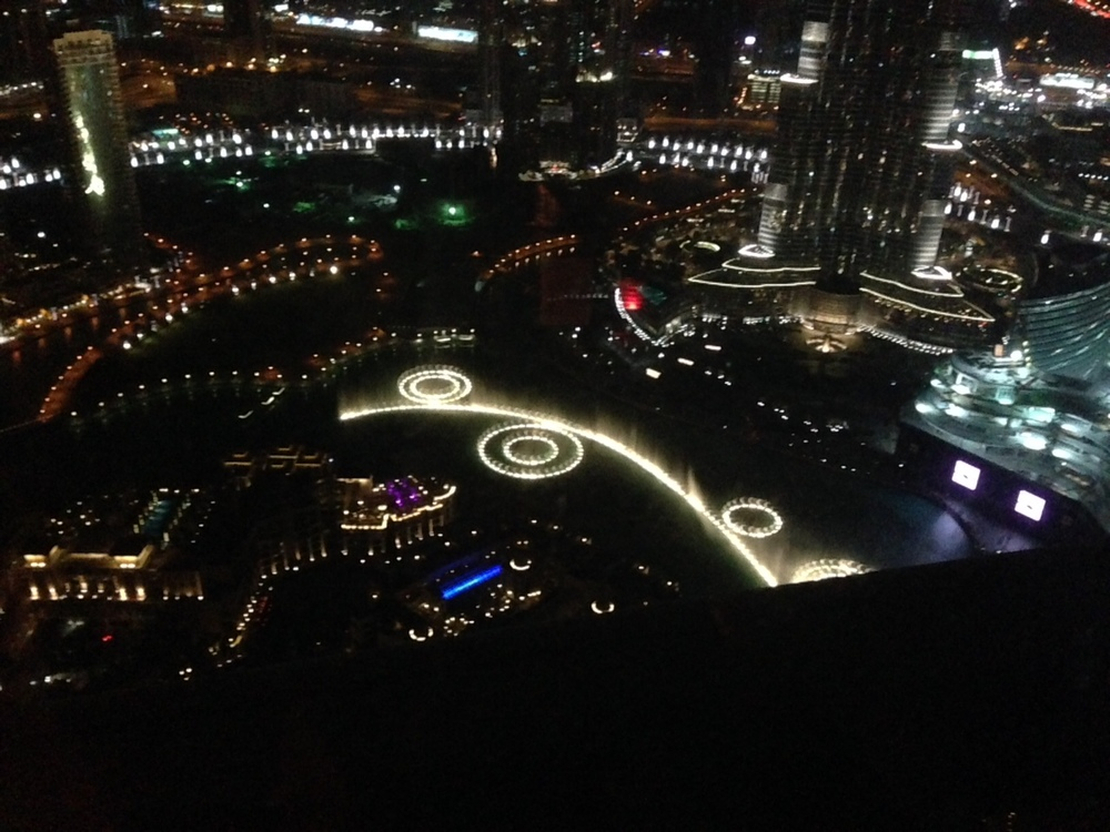 Dubai Fountain, the world's largest dancing fountain, as seen from a tower next to the Burj Khalifa. In the upper right corner of the photograph is the lower portion of Burj Khalifa. From this great height we were nevertheless still craning our necks to see the top of that epic skyscraper.