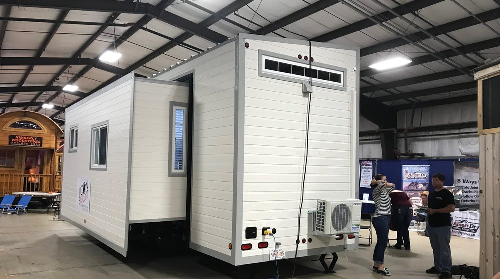 This one borrows the bump-out concept from large mobile homes.