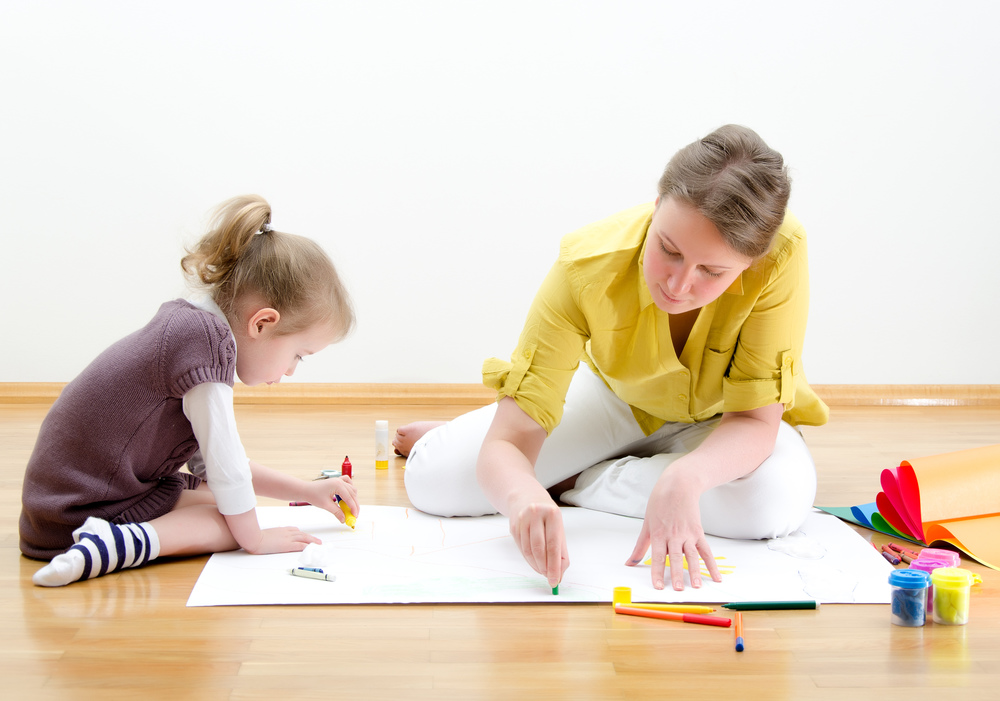 Art Therapist Drawing with Child