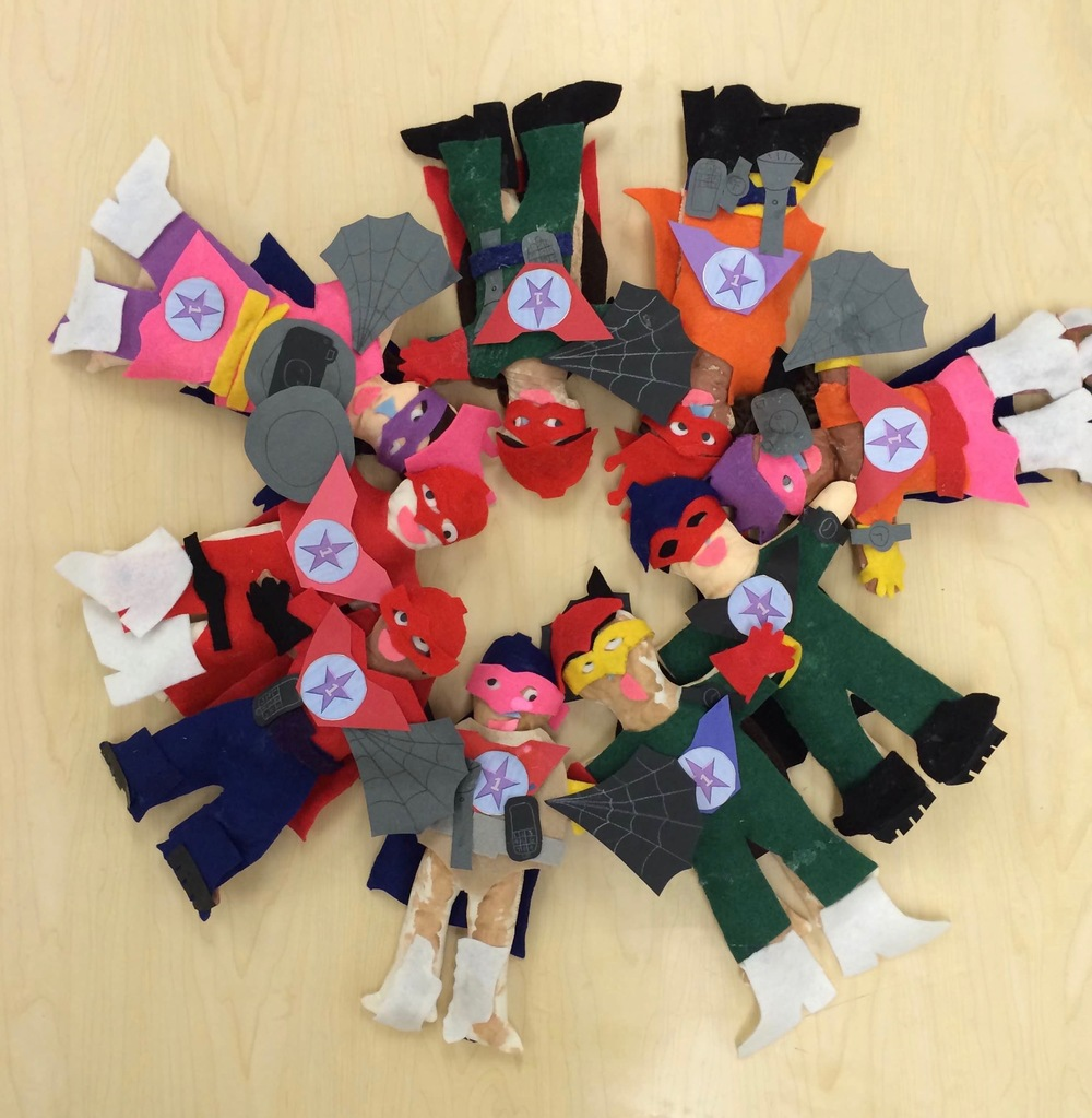Children make superheroes to learn about teamwork and social skills.