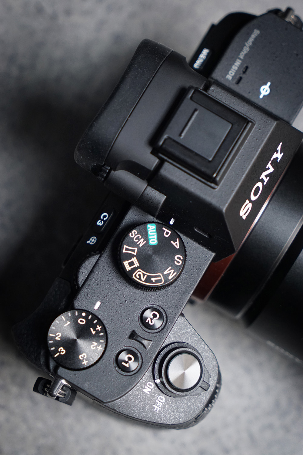 Sony's new A7II has a beefed up construction and a redesigned shutter release button and configuration, making it more comfortable and easy to grip.  Sony added an additional Custom button on the top and subsequently redesigned the accessory grip to match the new button layouts and design.  The camera weighs 100 grams more than the A7  and has reinforced the body with more magnesium alloy making it feel more rugged and durable.
