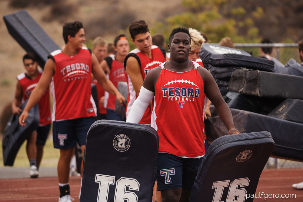 Tesoro players set up the field on Day One of Fall Camp at the school on Monday.  144 mm, 250 ISO, 1/50  0th at f2.8.