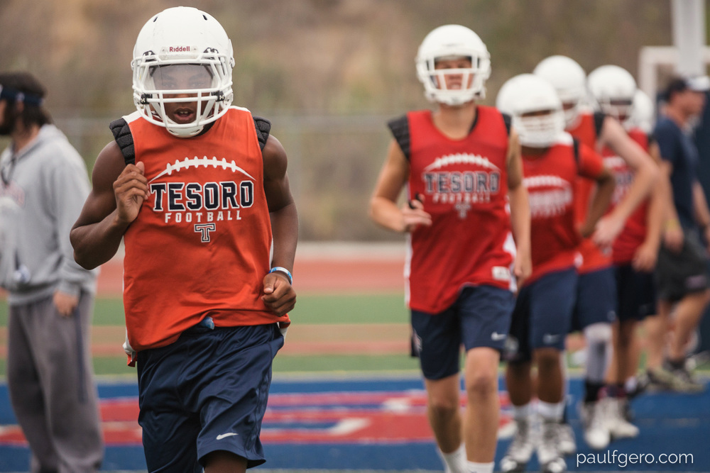 Tesoro players run during Day One of Fall Camp at the school on Monday.  181mm, 400 ISO, 1/100  0th at f2.8.