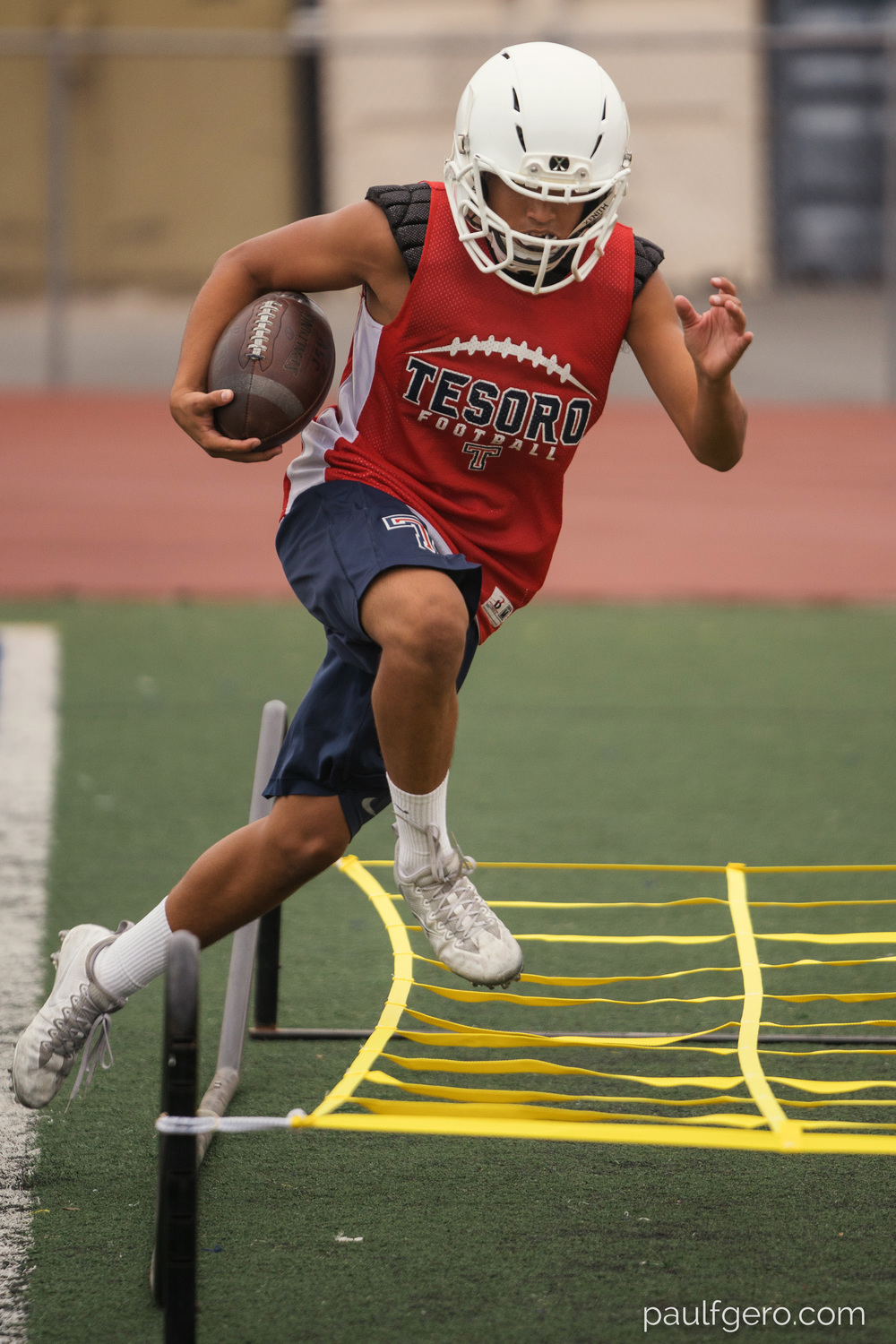A Tesoro player does agility drills during Day One of Fall Camp at the school on Monday.  200mm, 400 ISO, 1/100  0th at f2.8.
