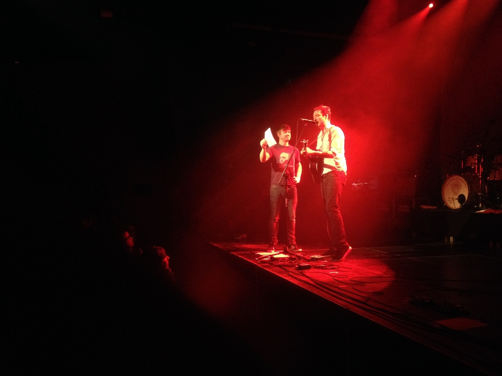"""Frank's singing a Dutch version of Eulogy ('Grafrede' in Dutch) whilst Cahir is holding up the lyrics. I've seen him sing the Dutch version 3 times now, and he is certainly getting better at the pronunciation! Still, some words are pronounced very creatively :)"" - Hanneke Bennett, attended Amsterdam."