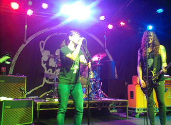 Billy Pettinger onstage with Laura Jane Grace and Against Me! - good shot!