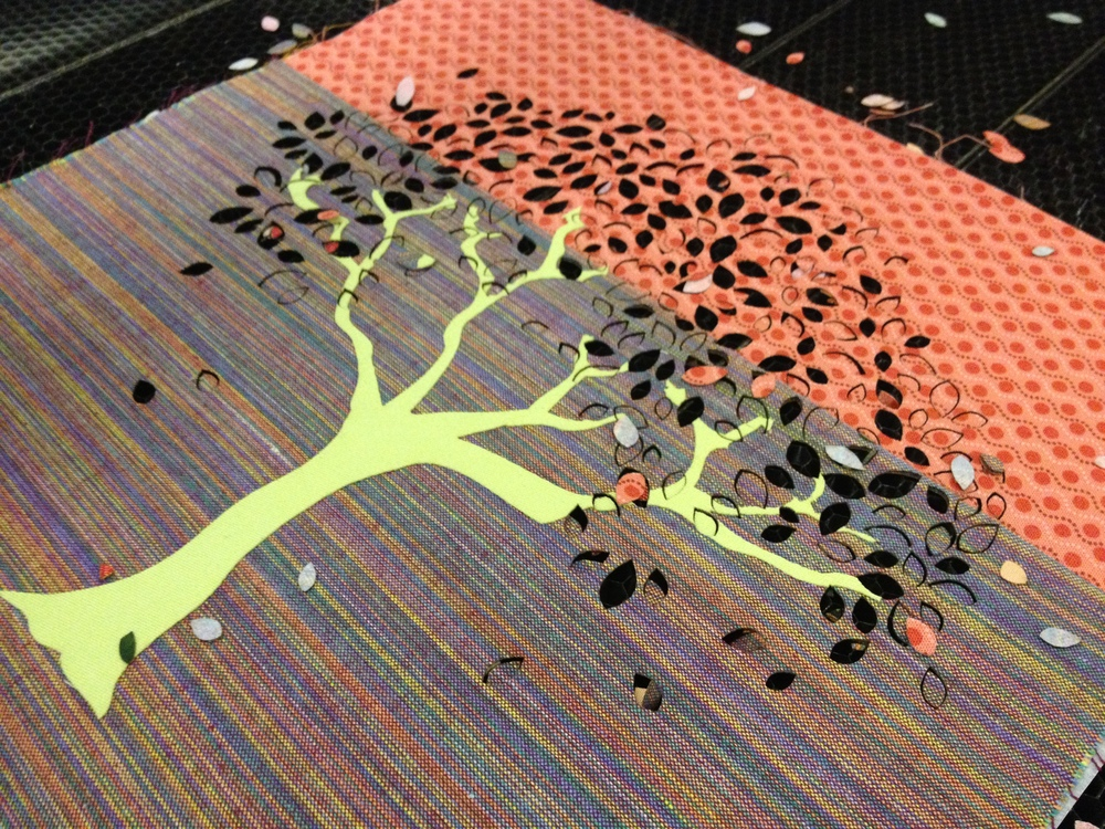 Leaves for the tree panels cut out by laser cutter