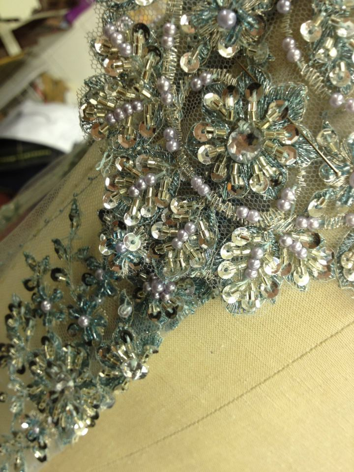 Trims being beaded for the Merry Widow.