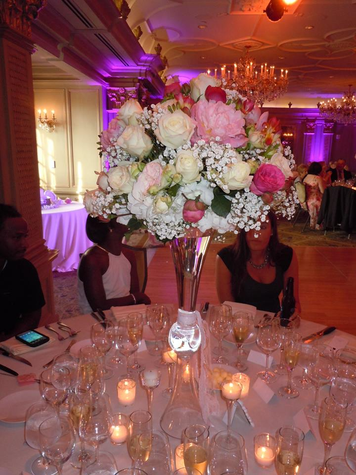 Pink up lighting, amber ceiling wash and pinspots on the flowers in the ballroom in or the Grand Bohemian Hotel in Asheville
