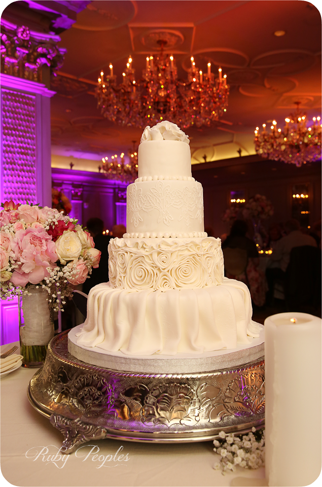 Pink uplighting, amber ceiling wash and a pinspot on the wedding cake in the ballroom of the Grand Bohemian Hotel in Asheville