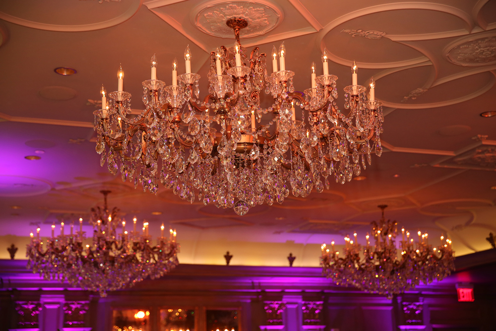 Amber ceiling wash and pink uplighting in the ballroom of the Grand Bohemian Hotel in Asheville