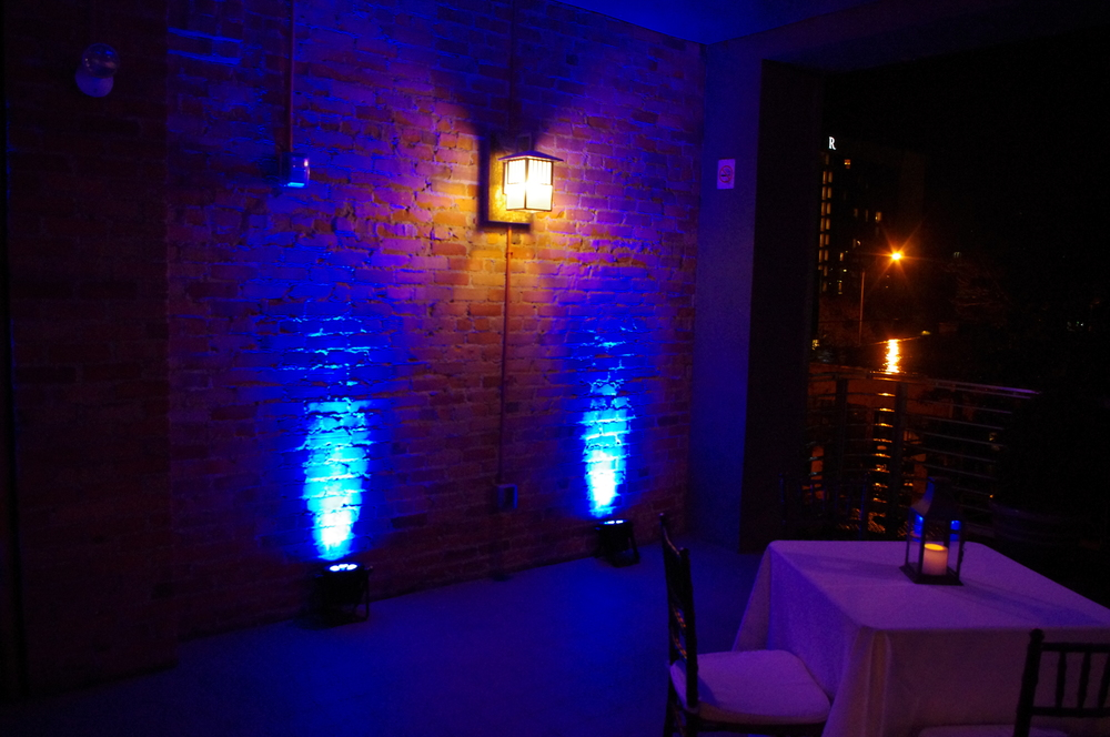 Blue uplighting on the Balcony at The Venue in Asheville