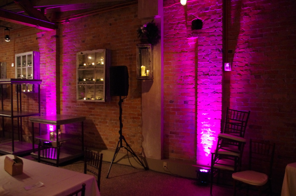 Pink uplighting and speakers at The Venue in Asheville