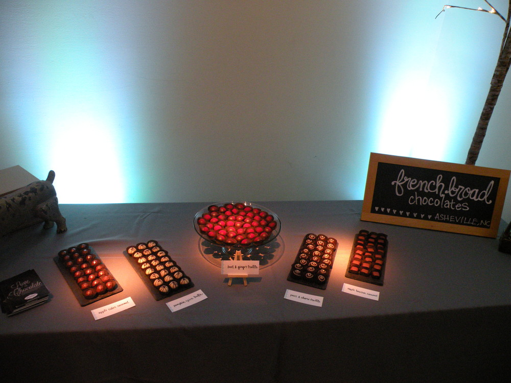 blue uplighting with pinspots on the truffle bar