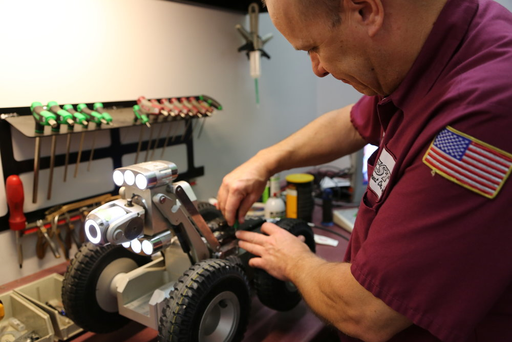 Pat Scheidler, Service Technician, works on an Envirosight Rovver X in the Midwest Envirosight Service Center at Best Equipment.