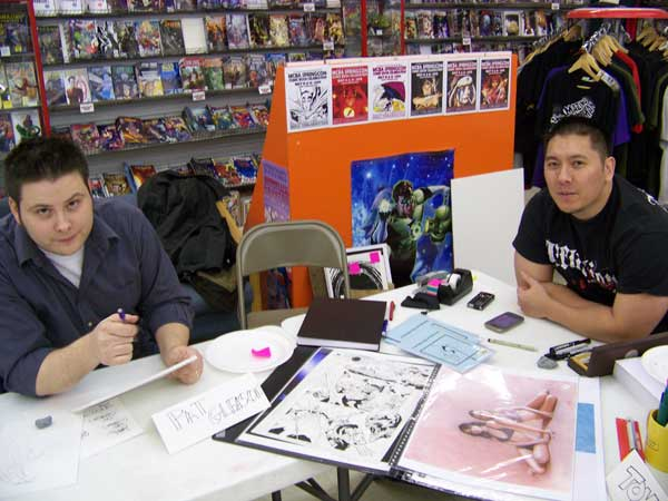 Current Batman and Robin artist Pat Gleason and I at a signing appearance.  Justice League artist Doug Mahnke lurks somewhere off-camera.