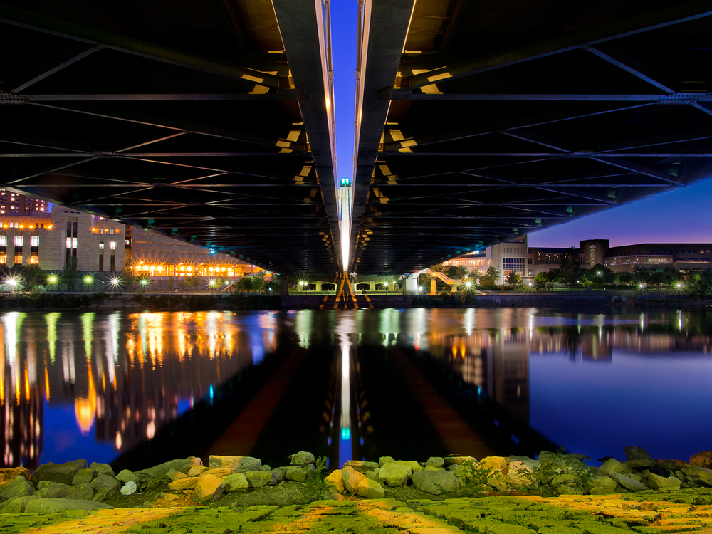 Underneath the Hennepin Avenue Bridge.  This was actually processed from two RAW images (one was exposed for darker sky on the right).