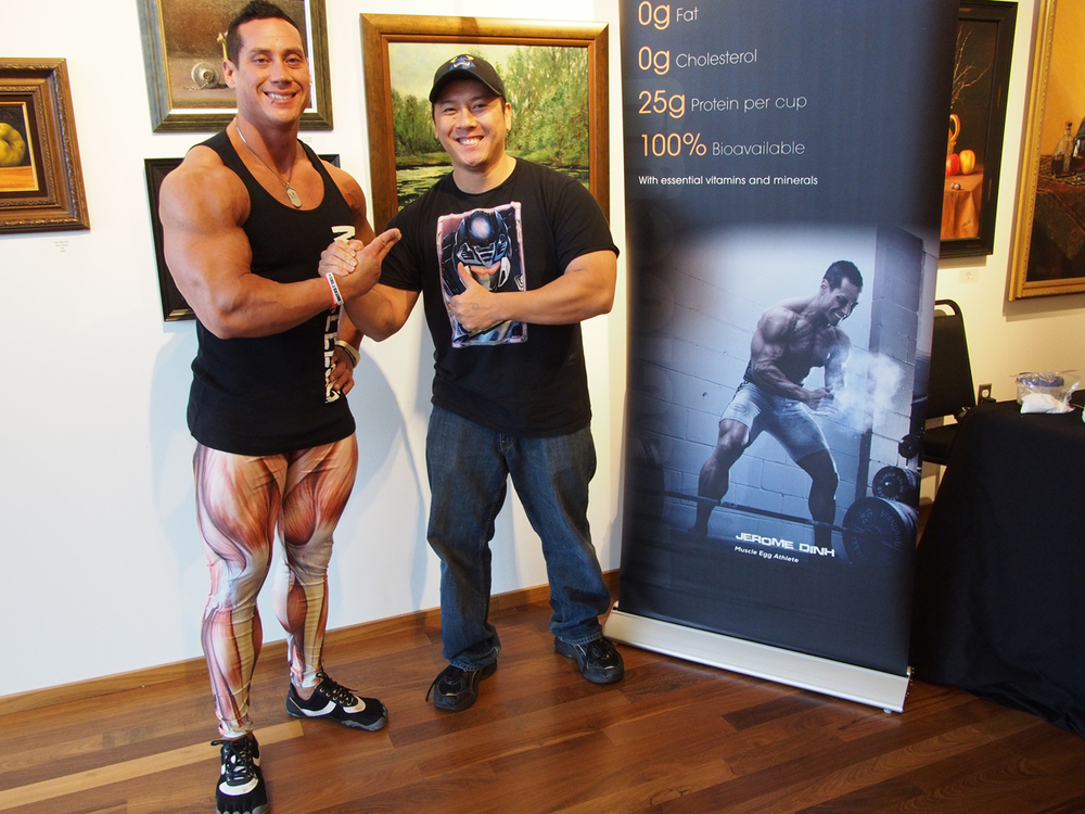 Outside the theater by the vendors area.  Me with bodybuilder  Jerome Dinh .  Recognize the photo on the banner? ;)