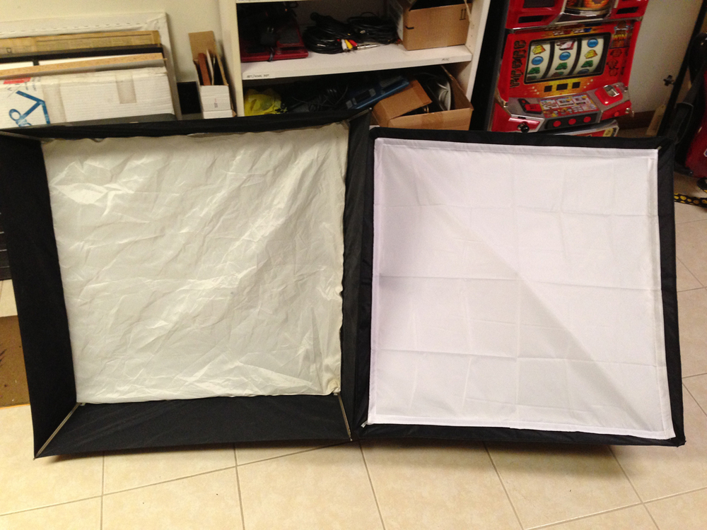 Compared to my 28-inch Westcott Apollo (left). Already you can see that the diffusion fabric of the Neewer (right)  looks much newer  (ha! bad joke). Actually, I don't know if it's because the Apollo is old and dirtier, or if it's supposed to have that off-white tint to it.  Also, notice the Apollo has a deeper recessed edge than the Neewer softbox.