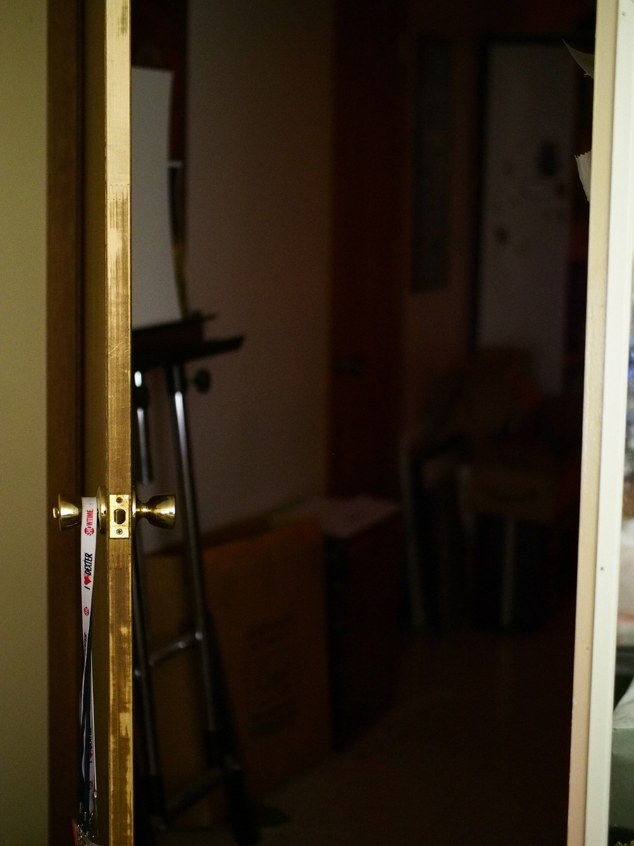 This is a straight-out-of-camera jpeg shot with the E-M5 and PL 42.5mm lens wide open at f/1.2.  Shutter speed was 1/10 with image stabilization on, and ISO 3200.  Focus on the door latch.