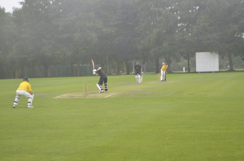 Battling on with the cricket despite the weather!