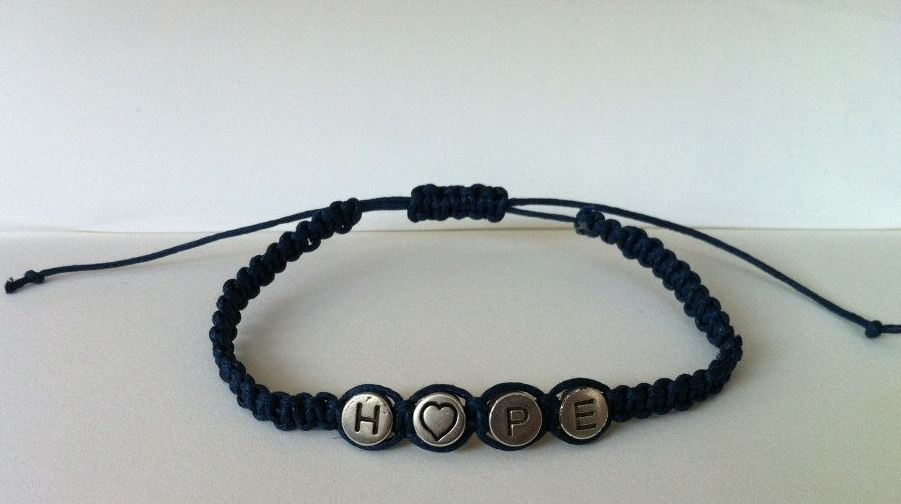 A waxed string Hope Bracelet. Choice of string colours and option of heart to be replaced by the letter o.     £2.50