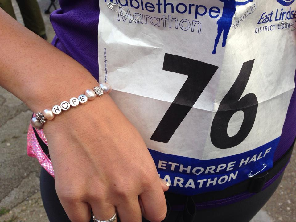 Helen wearing TheJHF pearl HOPE bracelet for good luck!