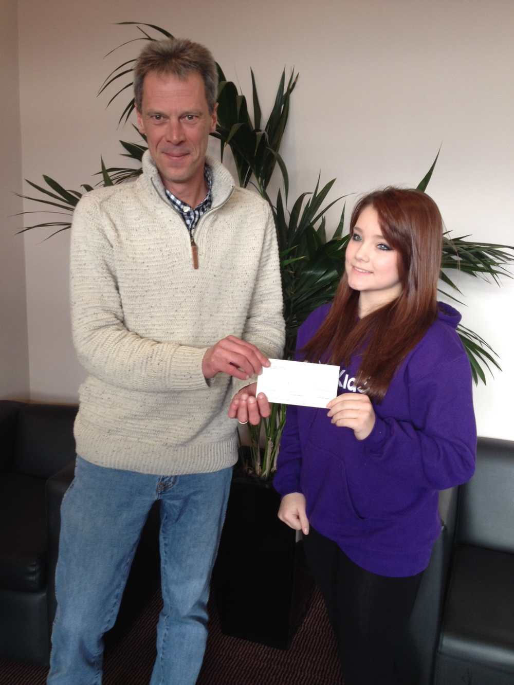 John receiving the cheque from Nicole earlier today