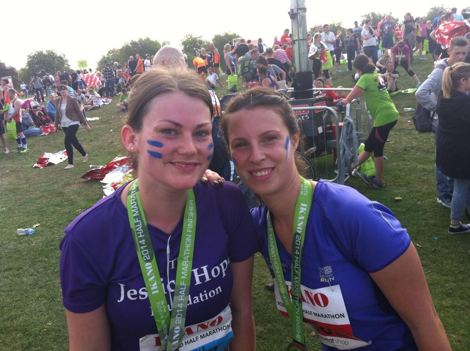 Hannah Lacey and Michelle Young celebrating finishing the half marathon in 2 hours 15 minutes.