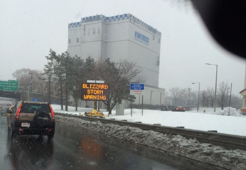 blizzard storm warning highway sign in north Boston