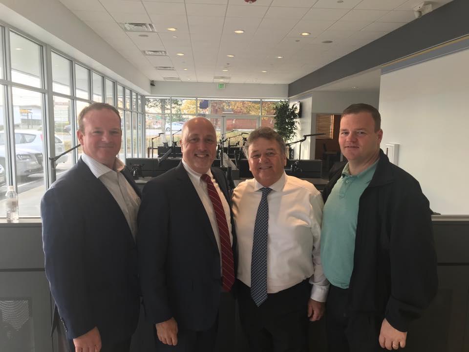 Mark Brewster, Brockton Mayor Bill Carpenter, George Brewster Sr. and George Brewster Jr. at the new Brockton Main Street location.