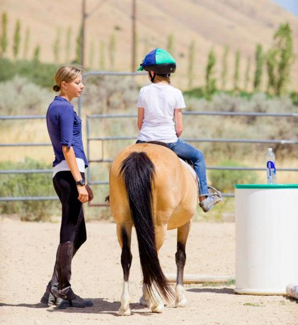Head instructor Kate explains to Rylie and Buttercup why it's important to cool down your horse after a good workout.