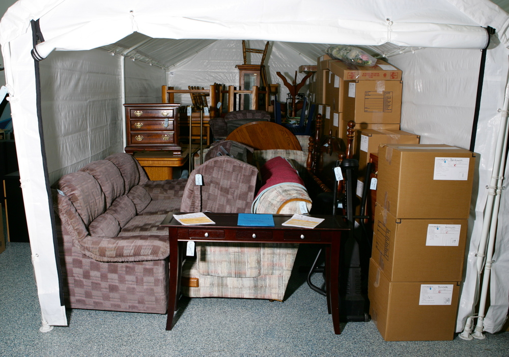 Tent storage units to separate each customers belongings. Every item and box is tagged, labeled and accounted for, from pick up, to delivery.