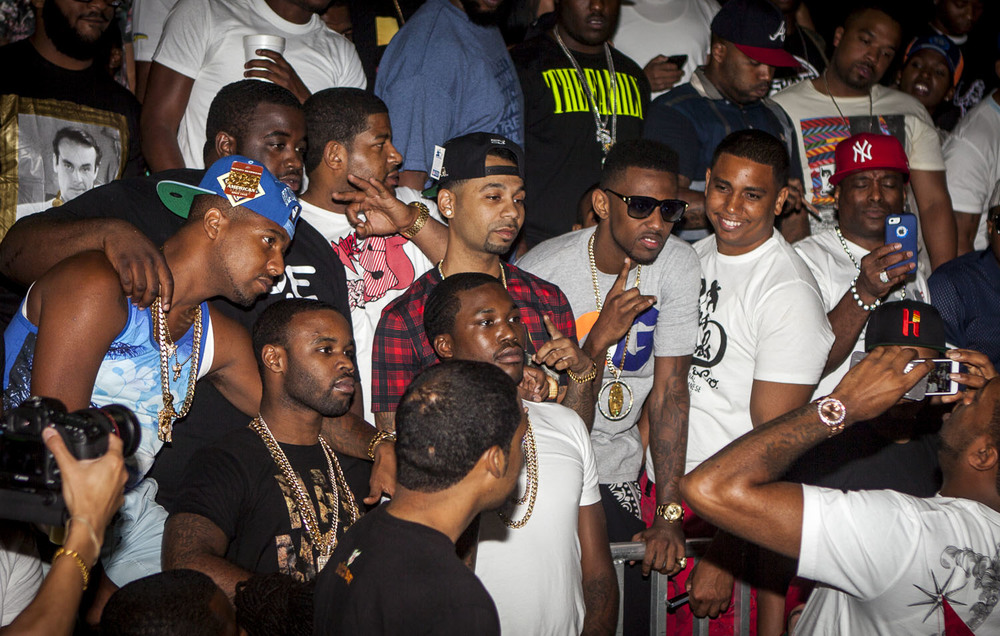 Juelz Santana, Meek Mill, and Fabolous pose for photos after the game.
