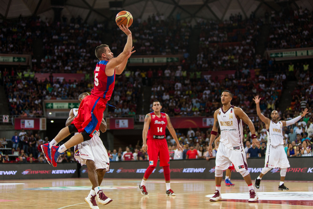 Jose Barea of Puerto Rico connected on a few off balance three pointers to help stun Venezuela in front of their jubilant home crowd.