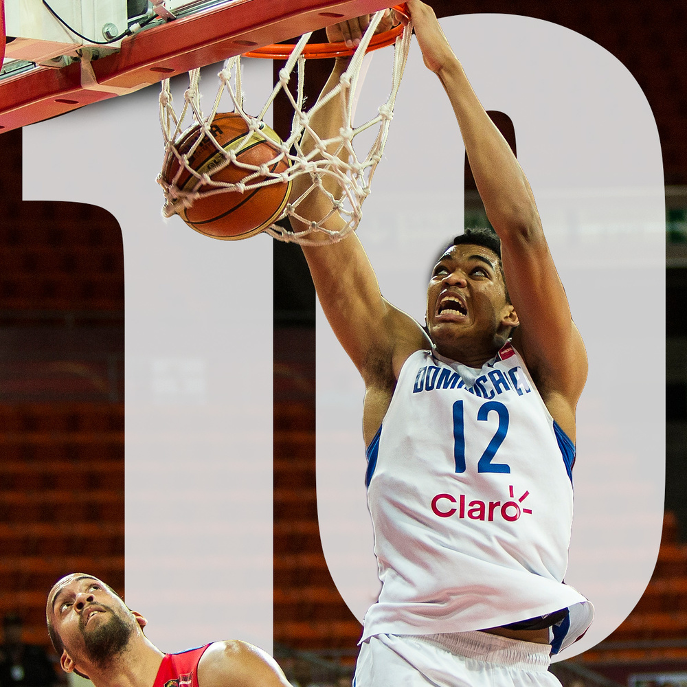 At number 10, Karl Towns of the Dominican Republic national team throws one down over the defense of Puerto Rico's Ricardo Sanchez at the FIBA America's tournament in Caracas, Venezuela.