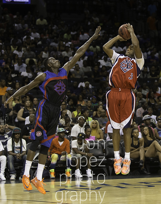 """Brooklyn Nets backup guard Jarret Jack suited up for his hometown (Washington DC/Maryland/Virginia) squad in the EBC Celebrity Game at the Barclays Center. Jack pulls up for a jumper over the outstretched arms of former Seton Hall Standout, Jeremy """"Cabbie"""" Hazell (black uniform)."""
