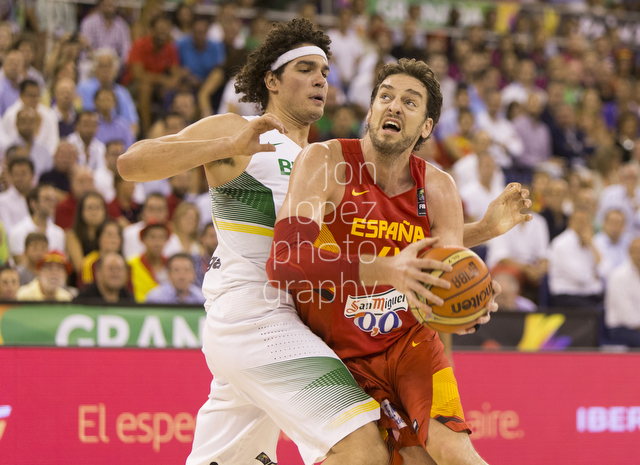Pau Gasol takes Anderson Varejao to the basket at the FIBA Basketball World Cup during the group phase in Granada, Spain.