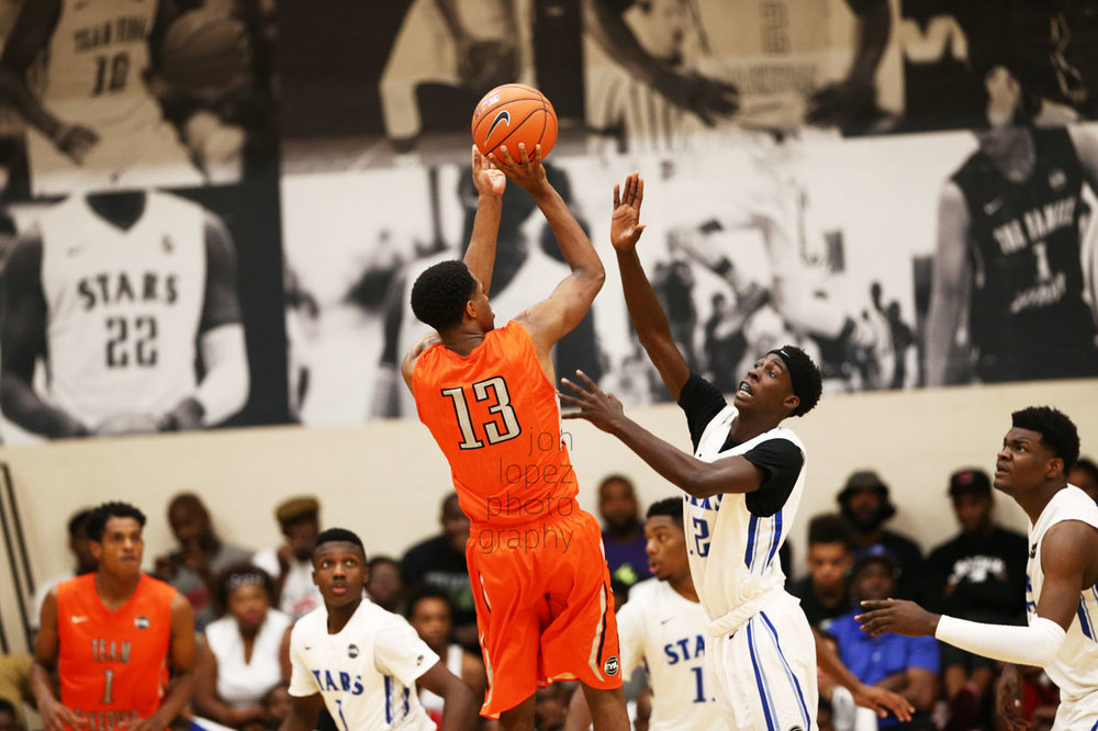 VJ King pulls up for a jumper during the Peach Jam final four. I was hyped to see my images from the EYBL season printed so large in the background.