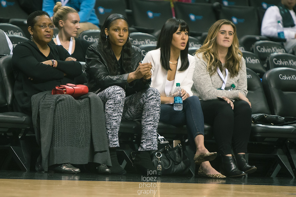 Minnesota Lynx guard and Jordan Brand athlete Maya Moore sits courtside during the inaugural girls Jordan Brand Classic game.