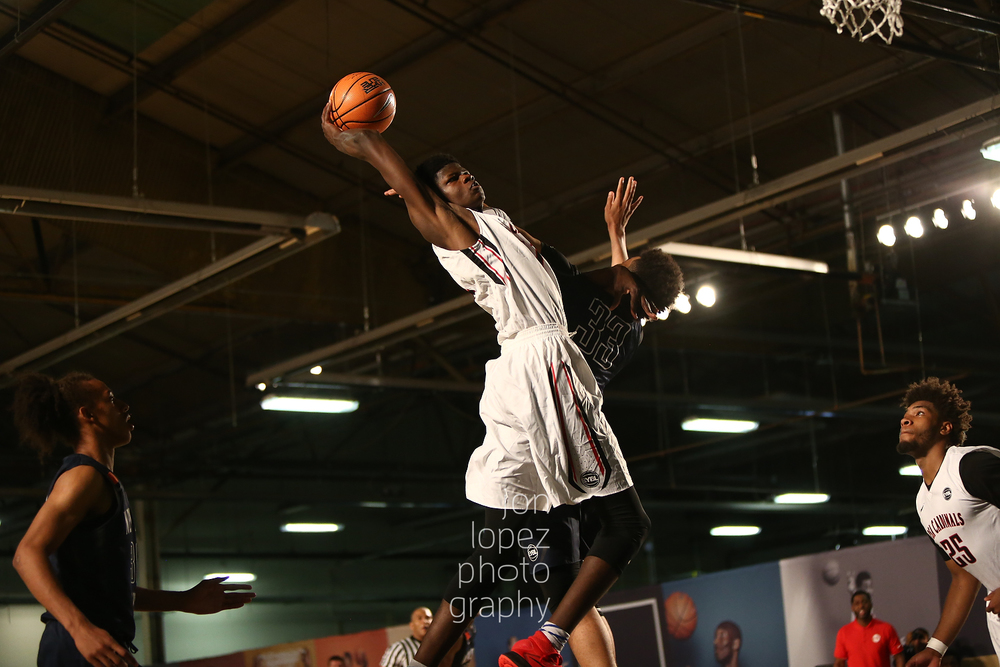 Mohamed Bamba #11 of the PSA Cardinals (NYC) attacks the basket.