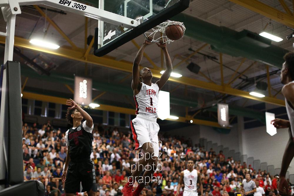 LAS VEGAS, NV. JULY 20, 2016. The Eight. Andre Rafus #1 of Team Melo dunks. (Mandatory photo credit: Jon Lopez/Nike).