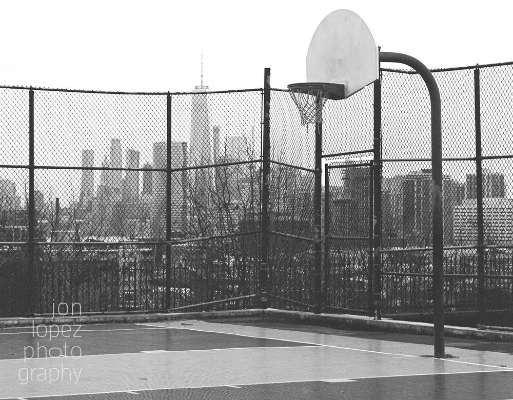 Searching for a memorable image of the super blue blood moon, I traveled to a basketball court with a view. Even aiming for a landscape image, I couldn't help but park myself on a playground. This photograph was taken on Kodak Tri-X 400 film using the Mamiya RB67. Photo credit: Jonathan Lopez