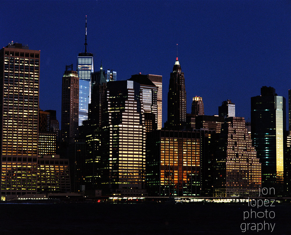 Taken on Fuji Pro 400h film, I turned my camera away from the moonset to enjoy the reflection of the sunrise gently grazing the New York skyline. Photo credit: Jonathan Lopez