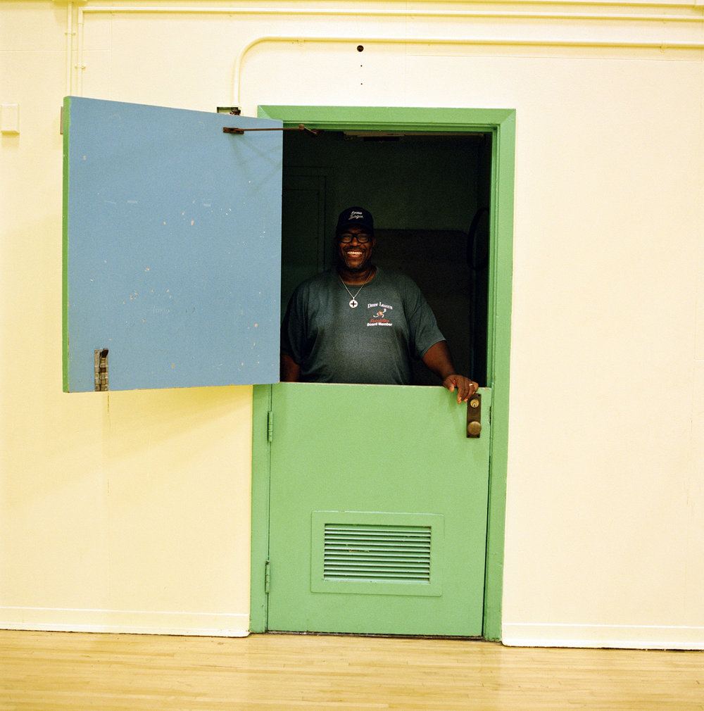 Drew League commissioner Mr. Smiley gave me the honor of showing me around some of the historic Drew League venues. He told me about the impact the league has had on the community and how he used to sign teams in, keep score, and sell snacks to keep the league alive. Here he is in the closet just a few feet from the sideline behind where the team benches used to live and from where he would sell refreshments to raise money for the league.
