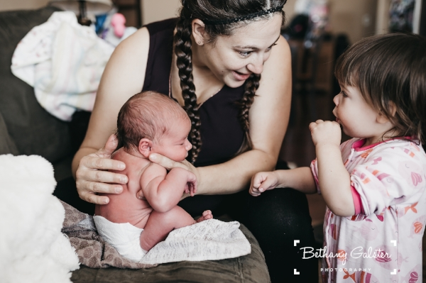Christine, Hazel, and Zoe at Zoe's newborn photoshoot; photo by Bethany Galster Photography