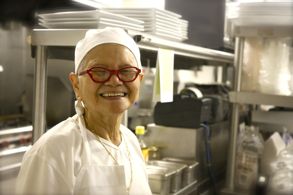 At the heart of our kitchen stands 81-year-old Grandma Vilai. Her exceptional cooking and extensive knowledge of Thai recipes are the inspiration behind Si Laa. She is the genius behind one of our signature dishes, the Hidden Treasures, and the talent behind all our savory noodles.