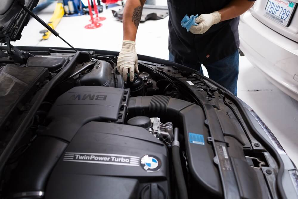 BMW intake cleaning in San Diego with walnut blasting.