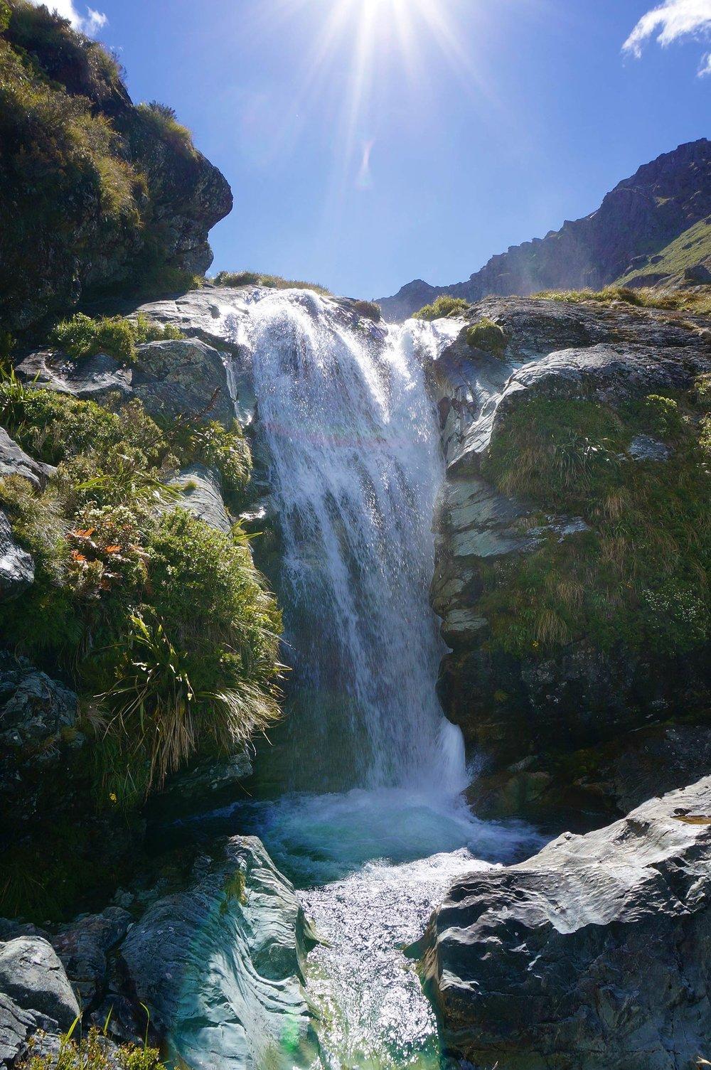 routeburn_track_waterfall_sun_flare.jpg